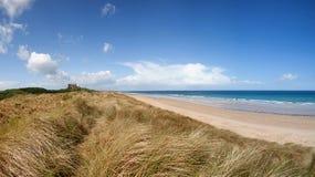 Bamburgh beach and castle Stock Photo