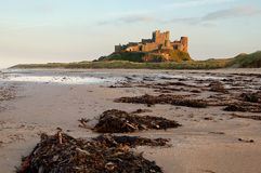Bamburgh Castle. Northumberland England at dusk stock photography