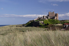 Bamburgh Castle. Northumberland from the sandunes stock photos
