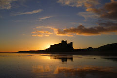 Bamburgh Castle. Northumberland at sunrise stock image