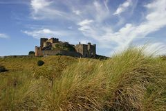 Bamburgh Castle. Looking up at Bamburgh Castle in England from the beach Royalty Free Stock Photos
