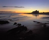 Bamburgh Castle. And North Sea at sunrise Stock Photography
