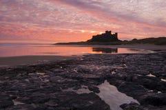 Bamburgh Castle. And reflection shortly before sunrise Royalty Free Stock Images