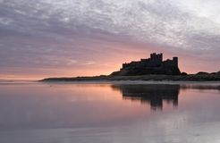 Bamburgh Castle. And reflection early morning Royalty Free Stock Photo