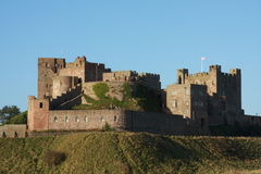 Bamburgh Castle. Northumberland, on the coast of North East England Stock Photography