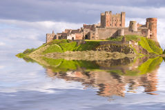 Bamburgh Castle as an island. Fantasy view of Bamburgh Castle surrounded by water Stock Photo