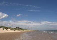 Bamburgh castle and beach Royalty Free Stock Photo