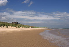 Bamburgh castle and beach Royalty Free Stock Photos