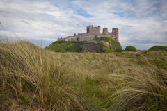 Bamburgh Castle. And beach in Northumberland Royalty Free Stock Image