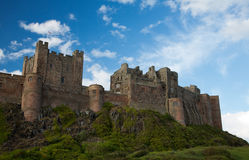 Bamburgh castle. At a blue sky Royalty Free Stock Photography