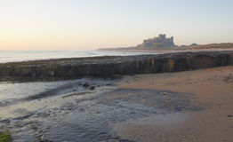 Bamburgh Castle at Dawn. Stock Image