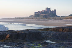 Bamburgh Castle at Dawn. Stock Photos