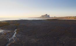 Bamburgh Castle at Dawn. Stock Images