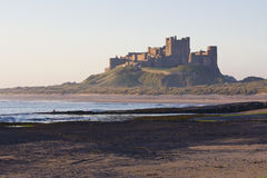 Bamburgh Castle at Dawn. Royalty Free Stock Photos