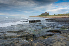 Bamburgh Castle from a distance England Stock Photography
