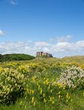 Bamburgh Castle England UK. Splendid medieval Bamburgh Castle Northumberland north east England UK panorama Stock Photo
