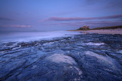 Bamburgh Castle. This is Bamburgh Castle in Northumberland, England. The Farne Islands are visible on the horizon Royalty Free Stock Image