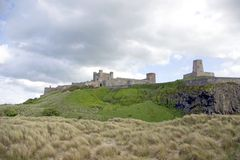 Bamburgh Castle from the sea Royalty Free Stock Photos