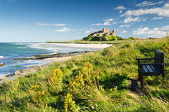 Bamburgh Castle and seat. Bamburgh Castle taken here from the north dates back to the 6/7th century Royalty Free Stock Photos