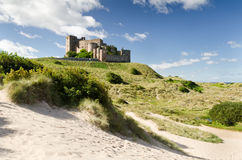 Bamburgh Castle from south. Bamburgh Castle taken here from the south dunes dates back to the 6/7th century Royalty Free Stock Images