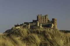 Bamburgh Castle in Northumberland at Sunset Stock Photography