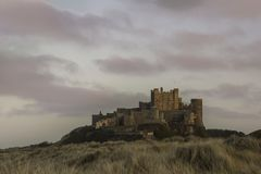 Bamburgh Castle in Northumberland at Sunset Royalty Free Stock Images