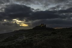 Bamburgh Castle in Northumberland at Sunrise Stock Image