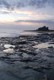 Bamburgh Castle at sunrise Stock Photo