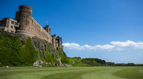 Bamburgh Castle. A vibrant shot of Bamburgh castle on a lovely summers day Royalty Free Stock Image