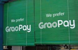 Bamburullgardiner som främjar GrabPay royaltyfria bilder