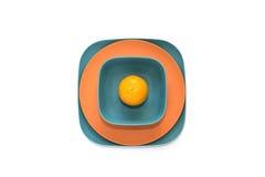 Bambusów talerze z pomarańcze zdjęcia royalty free