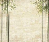 Bambusblätter auf altem grunge Antikepapier Lizenzfreie Stockfotografie
