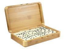 Bambuskasten mit Domino Stockfotografie