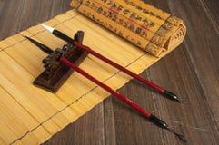 Bambusnedsteg och borste Fotografering för Bildbyråer