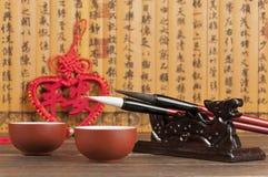 Bambusnedsteg och te Royaltyfri Fotografi