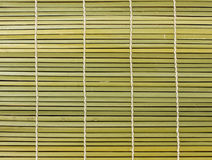 Bambusowa brown słomy mata jako abstrakcjonistyczny tekstury tło Zdjęcie Stock