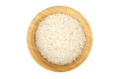 Bambusowy puchar stronniczo wypełniający z surowymi ryż Obrazy Royalty Free
