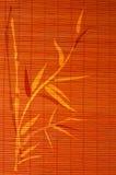 Bambusplatzmatte mit handdrawn Bild Lizenzfreies Stockfoto