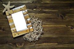 Bambusrahmen mit Starfish Lizenzfreies Stockbild
