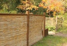 Bambustaket i höstträdgård Fotografering för Bildbyråer