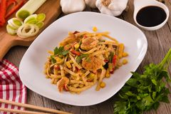 Bami goreng. Bami goreng with vegetables on white dish stock images