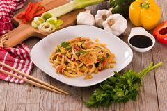 Bami goreng. Bami goreng with vegetables on white dish stock image
