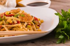 Bami goreng. Bami goreng with vegetables on white dish royalty free stock photos