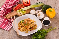 Bami goreng. Bami goreng with vegetables on white dish royalty free stock photography