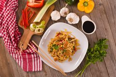 Bami goreng. Bami goreng with vegetables on white dish stock photography