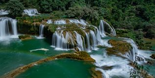 Ban Gioc/Detian waterfall. Ban Gioc is the most beautiful one in VietNam. It is also the natural border between Vietnam and China. Haft of this biggest part of Royalty Free Stock Images
