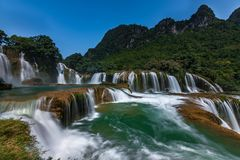 Ban Gioc/Detian waterfall. Ban Gioc is the most beautiful one in VietNam. It is also the natural border between Vietnam and China. Haft of this biggest part of Stock Photos