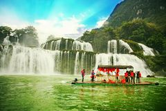 Ban Gioc waterfall, Cao Bang province, Vietnam - April 5, 2017 : tourists on the boat are going to enjoy and explore Ban Gioc Stock Image