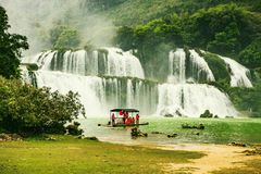 Ban Gioc waterfall, Cao Bang province, Vietnam - April 5, 2017 : tourists on the boat are going to enjoy and explore Ban Gioc Stock Images