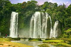 Ban Gioc waterfall in Cao Bang, Viet Nam - The waterfalls are located in an area of mature karst formations were the original. Limestone bedrock layers are stock photography